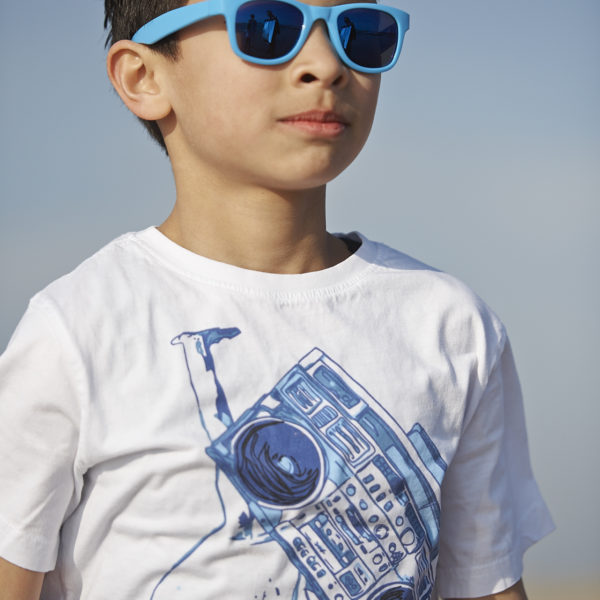 Real Kids Shades Lifestyle Image - Surf in Neon Blue 001