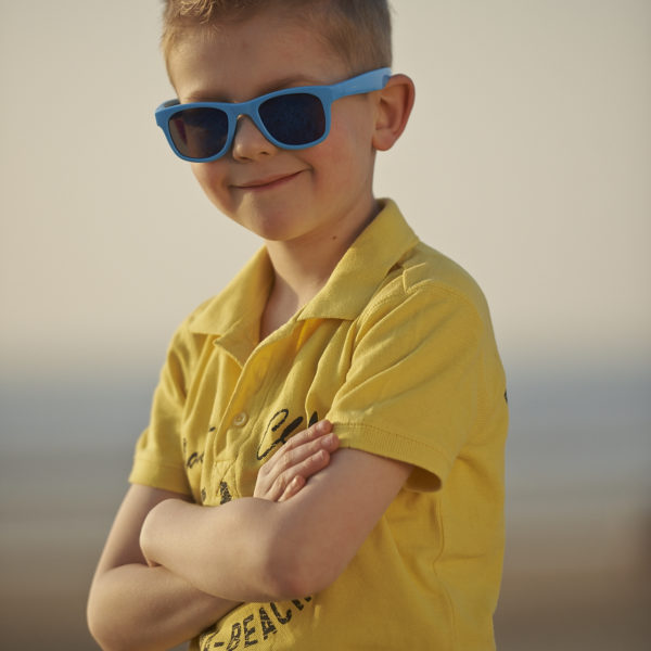 Real Kids Shades Lifestyle Image - Surf in Neon Blue 002