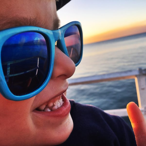 Real Kids Shades Lifestyle Image - Surf in Neon Blue 004