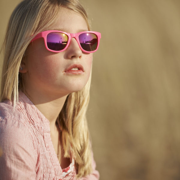 Real Kids Shades Lifestyle Image - Surf in Neon Pink 001