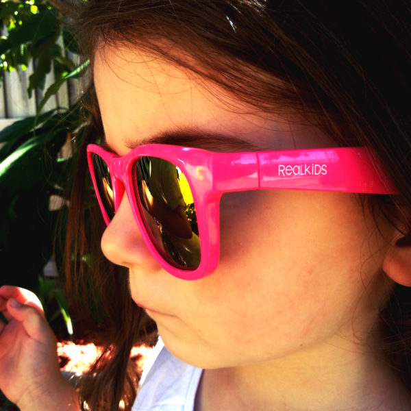 Real Kids Shades Lifestyle Image - Surf in Neon Pink 002